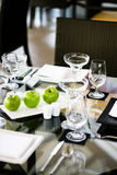 Table setting. Elegant table setting with apples and crystal glasses stock photography