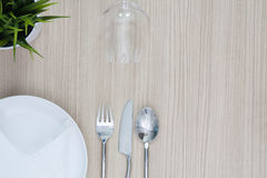 Table setting from above elegant empty plate cutlery napkin and. Glass. flat lay Stock Photography