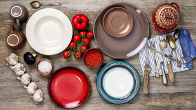 Table setting with antique dishes and vegetables Royalty Free Stock Image