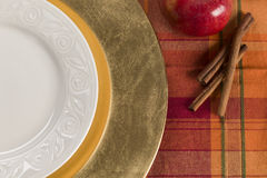 Table Setting of Apple and Cinnamon with Plate Royalty Free Stock Photo