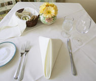 Table Setting. With a basket of bread Stock Photography