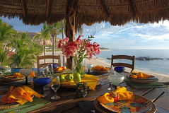 Table setting at the beach. Lunch table setting with beach view in Baja Mexico royalty free stock photo