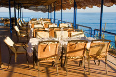 Table setting at beach restaurant. With sea on background Stock Photos