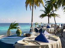 Table setting at beach restaurant. In hotel resort Royalty Free Stock Image