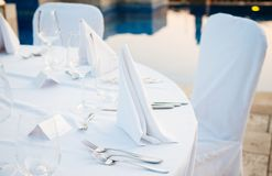 Table setting at beach restaurant Stock Image