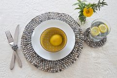 Table setting with beaded mats Royalty Free Stock Image