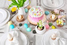Table setting with beautiful cake and Easter Stock Photo