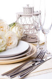 Table setting with beige roses royalty free stock photo