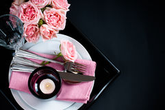Table setting on black background Stock Photography