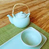Table setting and blue teapot Stock Photography