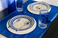 Table setting with blue theme for couple Royalty Free Stock Photography
