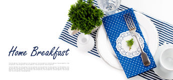 Table setting for breakfast in navy blue tones Stock Image