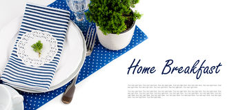 Table setting for breakfast in navy blue tones Royalty Free Stock Photo