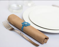 Table setting with brown napkin Royalty Free Stock Image
