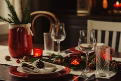Table setting for celebration Christmas and New Year Holidays. Festive table in classic red and green at home with rustic details. Table setting for celebration Stock Images