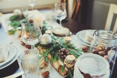 Table setting for celebration Christmas and New Year Holidays. Festive table at home with rustic details. Table setting for celebration Christmas and New Year Stock Photography