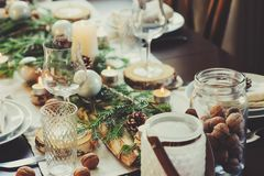 Table setting for celebration Christmas and New Year Holidays. Festive table at home with rustic details Stock Image