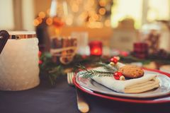 Table setting for celebration Christmas and New Year Holidays. Festive table in classic red and green at home with rustic details. Table setting for celebration Royalty Free Stock Photos