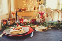 Table setting for celebration Christmas and New Year Holidays. Festive table in classic red and green at home with rustic details. Table setting for celebration Stock Photos