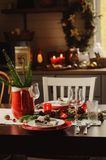 Table setting for celebration Christmas and New Year Holidays. Festive table in classic red and green at home with rustic details. Table setting for celebration Royalty Free Stock Photo