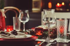 Table setting for celebration Christmas and New Year Holidays. Festive traditional red and green table at home with rustic details stock image