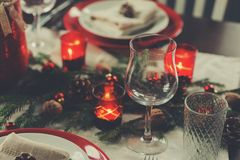 Table setting for celebration Christmas and New Year Holidays. Festive traditional red and green table at home. With rustic details Stock Images