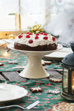 Table setting with chocolate cake Royalty Free Stock Image