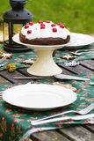 Table setting with chocolate cake Stock Photos