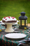 Table setting with chocolate cake Stock Image
