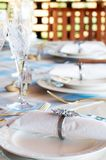 Table setting with crystal glasses. And decorative cutlery Stock Photography
