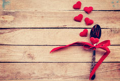Table setting cutlery and red heart for dinner Valentine Day. Royalty Free Stock Photos
