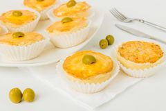 A Table setting decorated with tiny brazilian chicken pies stock photos