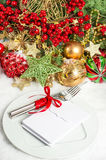 Table setting decoration with red baubles golden garlands Stock Photo