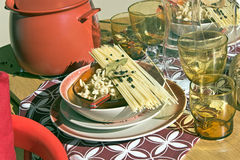 Table setting with dry spaghetti Royalty Free Stock Image