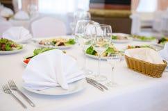 Table setting, elegant restaurant interior. Elegant decoration of table in a restaurant Stock Image