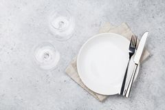 Table setting. Empty plate, knife, fork, wine glasses and napkin. Top view and flat lay with copy space stock images