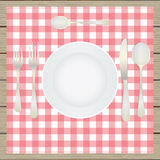 Table setting, etiquette. Plate, fork, spoon, knife, table-napki Royalty Free Stock Photography