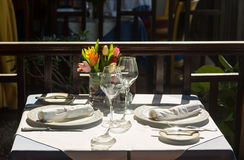 Table setting exterior restaurant in sunshine Stock Image