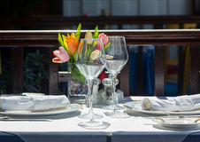 Table setting exterior restaurant in sunshine Royalty Free Stock Image