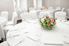 Table setting, festive round tables ready for guests. Beautifully organized event. floral arrangement in the center. fresh flowers cut-off Stock Images