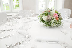 Table setting, festive round tables ready for guests. Beautifully organized event. floral arrangement in the center. fresh flowers cut-off Royalty Free Stock Photos