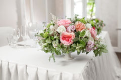 Table setting, festive tables ready for guests. Beautifully organized event. floral arrangement, fresh flowers cut-off Royalty Free Stock Image
