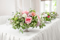 Table setting, festive tables ready for guests. Beautifully organized event. floral arrangement, fresh flowers cut-off Stock Images