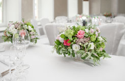 Table setting, festive tables ready for guests. Beautifully organized event. floral arrangement, fresh flowers cut-off Royalty Free Stock Images
