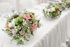 Table setting, festive tables ready for guests. Beautifully organized event. floral arrangement, fresh flowers cut-off Royalty Free Stock Photo