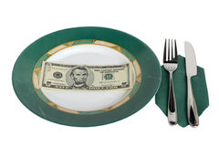 Table Setting and Five Dollars. Five dollar bill on a green plate with fork and knife Stock Photography