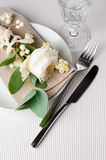 Table setting with floral decoration Stock Photography