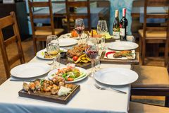 Table setting with food in the restaurant Stock Photo