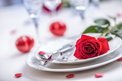 Free Table Setting For Valentines Or Wedding Day With Red Roses. Romantic Table Setting For Two With Roses Plates Cups And Cutlery Stock Image - 84397901