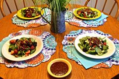 Table setting with four salads Royalty Free Stock Photography